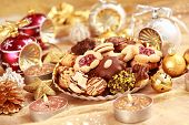 stock photo of christmas cookie  - Detail of delicious Christmas cookies with candles in golden tone - JPG