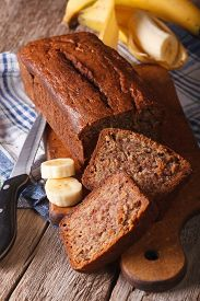 foto of fresh slice bread  - Delicious freshly baked banana bread sliced on a table close - JPG