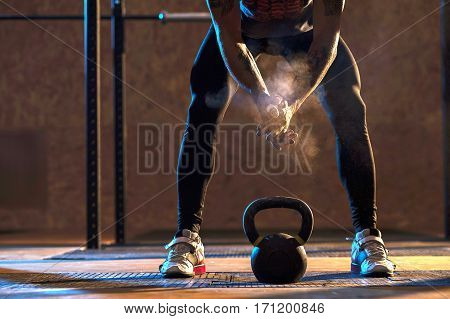 poster of Muscular man exercising with kettlebell in gym. Weightlifting training. sports, fitness concept.