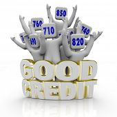 Several people with great credit scores on their heads cheer behind the word Good Credit