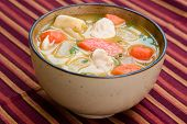 stock photo of cho-cho  - A bowl of caribbean style chicken soup with carrots potatoes herbs and cho - JPG