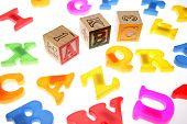 Alphabet blocks over white