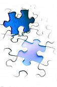 Jigsaw puzzle piece next to gap. Blue tone. Copy space.