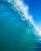 Perfect Blue Surfing Wave breaks in Tropical Ocean