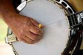stock photo of bluegrass  - Close up of man playing banjo with narrow depth of field - JPG