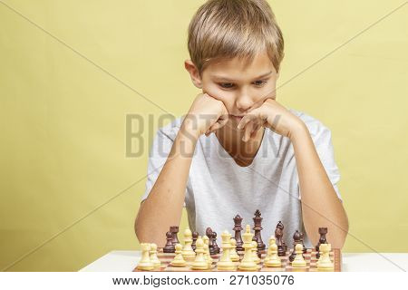 Little Girl Looking At Chess