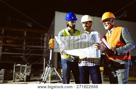 poster of Group Of Construction Engineer Working In Construction Site