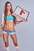 Beautiful Boxing Ring Girl Wearing A Bra And Shorts Holding A Board With A Round Number, Isolated On poster
