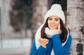 Happy Woman Applying Skin Moisturizing Cream Outdoors In Winter poster