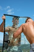 Strong And Full Of Energy. Twins Men Punch A Glass. Twins Competitors Show Muscular Strength And Pow poster