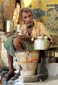 Indian Man Preparing Masala Chai