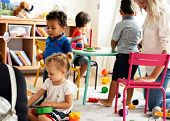 Nursery children playing with teacher in the classroom poster