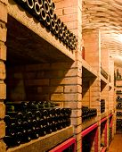 image of wine bottle  - stacked up wine bottles in the cellar - JPG