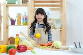 Healthy Family. Kid Girl Cooking And Cutting Vegetables For Healthy Care On Kitchen.  Daughter Makin poster