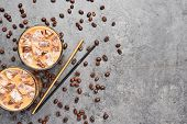 Cold Brewed Iced Coffee In Tall Glass With Coffee Beans And Straws On Grey Concrete Background. Choc poster
