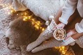 Cold autumn or winter weekend while drinking warm cocoa with marshmellows. Lazy day in knitted socks poster