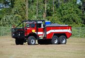 picture of disaster preparedness  - Red and white off road truck for exstinguishing fires - JPG