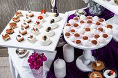 Candy Bar. Wedding Reception Table With Sweets, Candies, Dessert, Meringues, Fruit Tart, Cupcakes, M poster
