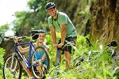 Cute adorable couple smile and are happy with mountain bike outdoors