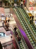 People in the multilevel mall, motion blurred