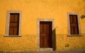 Yellow Adobe House Brown Doors Morelia Mexico