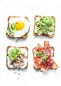 Variety Of Sandwiches For Breakfast, Snack, Appetizers - Avocado Puree, Fried Egg, Tomatoes, Bacon,  poster