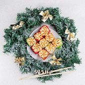 Christmas Sushi. New Year Sushi. Sushi And Christmas Wreath And The Word Sushi. Square Photo. poster
