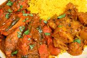 Indian chicken jalfrezi curry with Bombay aloo and pilau rice.
