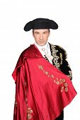 Man in a matador costume with a red cape