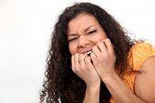 Nervous woman biting nails