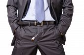 Young Businessman mockingly showing a usb cable out of his pants