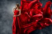 Beautiful Woman In Red Waving Silk Dress As A Flame