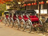 picture of rickshaw  - Group of rickshaws in Arashiyama area Kyoto Japan - JPG