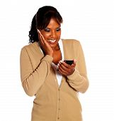Cheerful Young Woman Reading Message On Cellphone