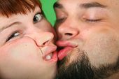 Close Up Girl With Red Hair And Guy Grimace