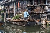 foto of gondolier  - Chinese gondolier at boat - JPG