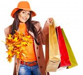 stock photo of overcoats  - Woman wearing autumn overcoat and hat holding shopping bag - JPG