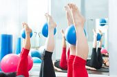 Aerobics pilates women feet  with yoga balls in a row on fitness class