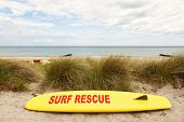 Yellow coast guard rescue surfboard at the baltic sea beach