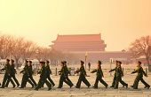 BEIJING, CHINA - APR 1: Team of soldier walk by Tiananmen in the morning on April 1, 2013 in Beijing