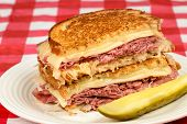 Corned Beef Reuben Sandwich - Fresh corned beef on grilled Rye with melted Swiss and sauerkraut.