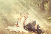 stock photo of skinny  - A young beautiful couple in a forest - JPG