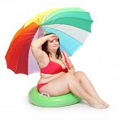 Funny obese woman on the beach.