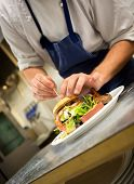stock photo of faceless  - Detail of a chef preparing a gourmet burger - JPG