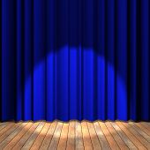 Blue Curtain Stage With A Spot Light