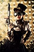 stock photo of post-apocalypse  - Portrait of a beautiful steampunk woman holding a gun over vintage background - JPG