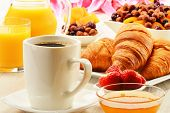 stock photo of croissant  - Breakfast with croissants cup of coffee and fruits - JPG