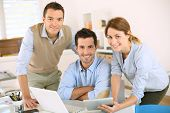 stock photo of cheer up  - Smiling business team looking at camera - JPG