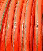 Rolled Up Of Orange Plastic Hose