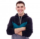 Smiling young man in hoodie with crossed arms on his chest. Isolated on white background, mask included